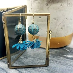 Teal dangle earrings with gold accents and tassel